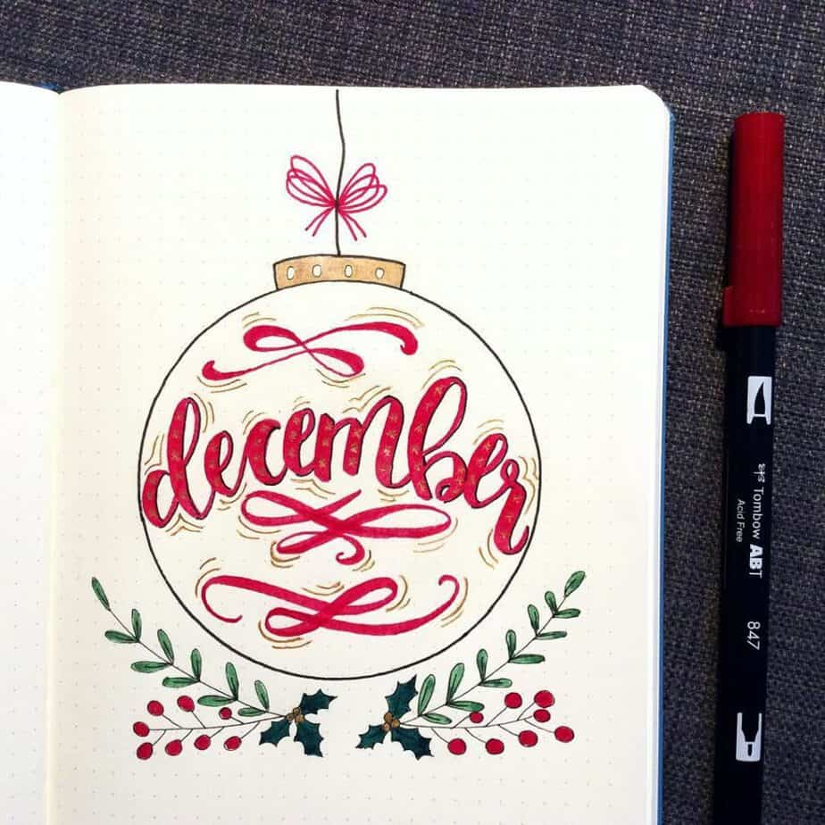 Gorgeous ornament bullet journal cover page by @vukada_bujo Pretty ornament and mistletoe for the holiday season!