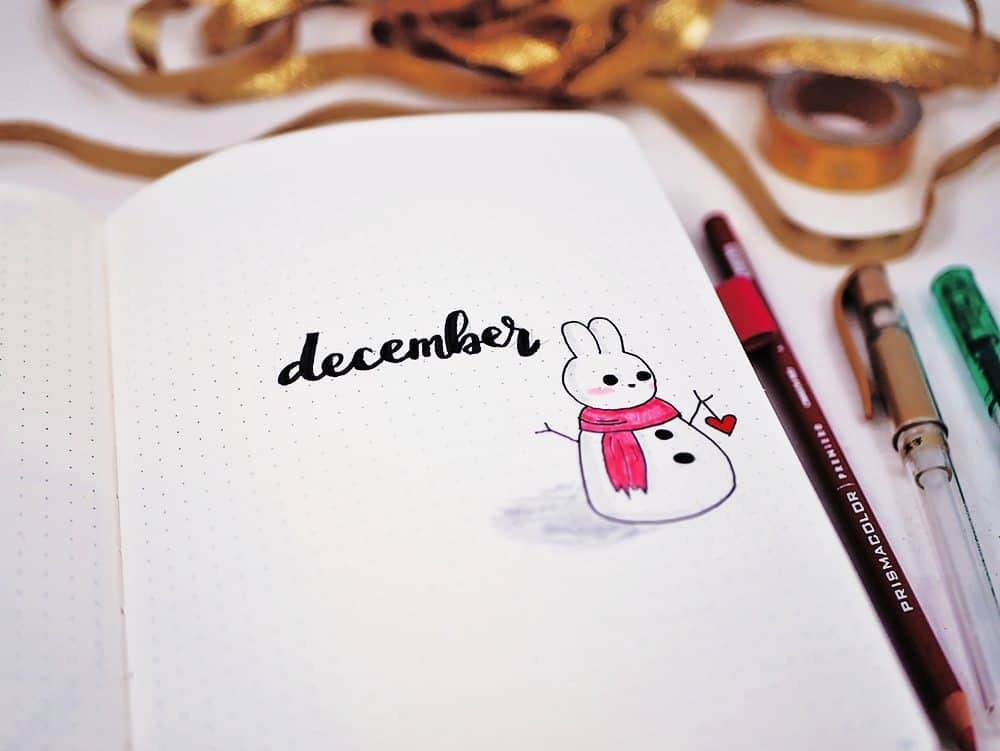 December cover page for bullet journal with snowbunny doodle