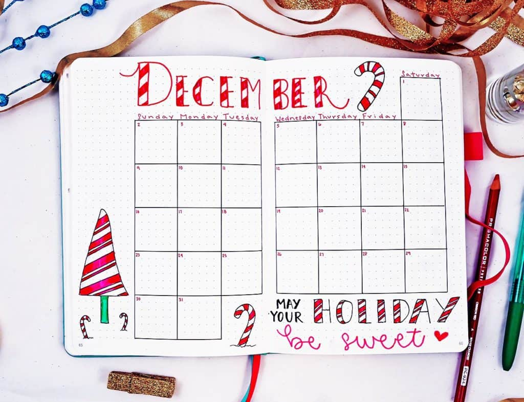December bullet journal holiday theme monthly calendar with candy cane doodles