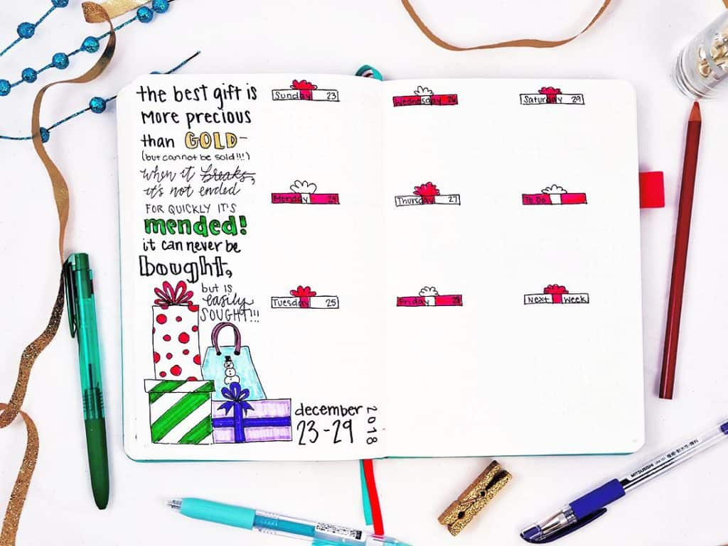 Bullet journal weekly layout for December with present doodles and Christmas quote