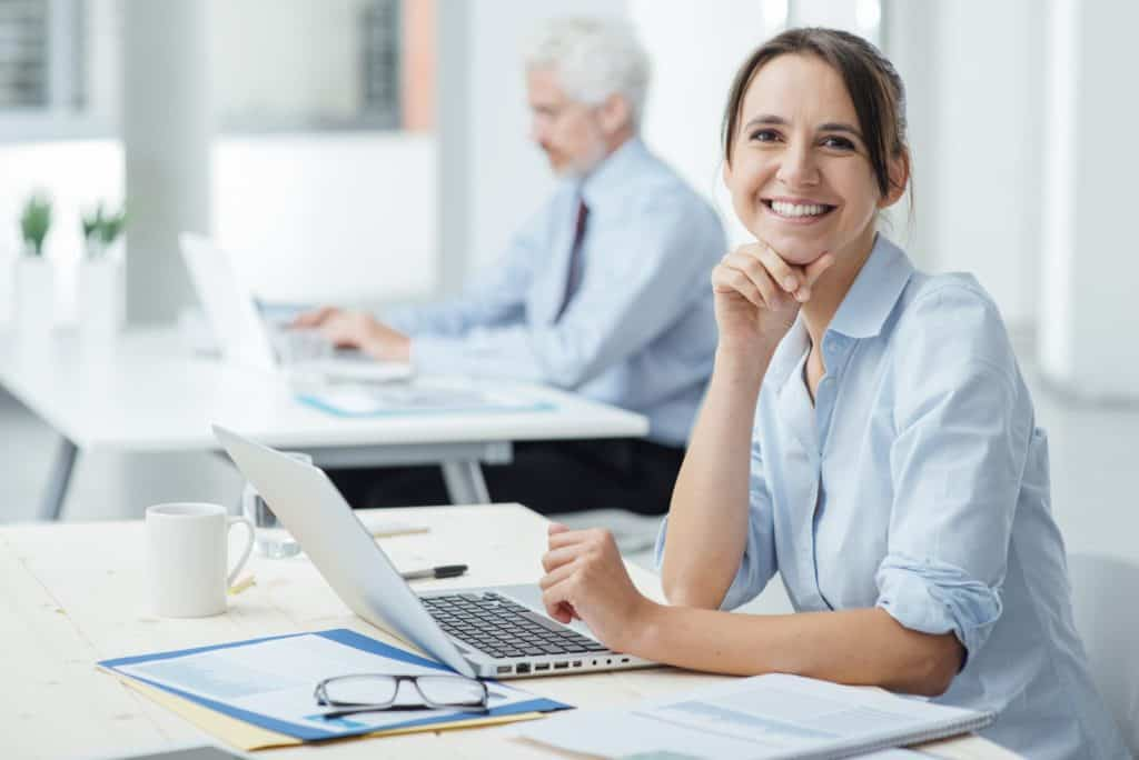 Woman happily taking responsibility for her work.