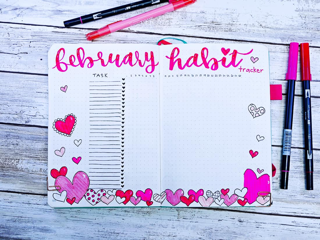 February habit tracker bullet journal layout with a heart border lots of heart doodles