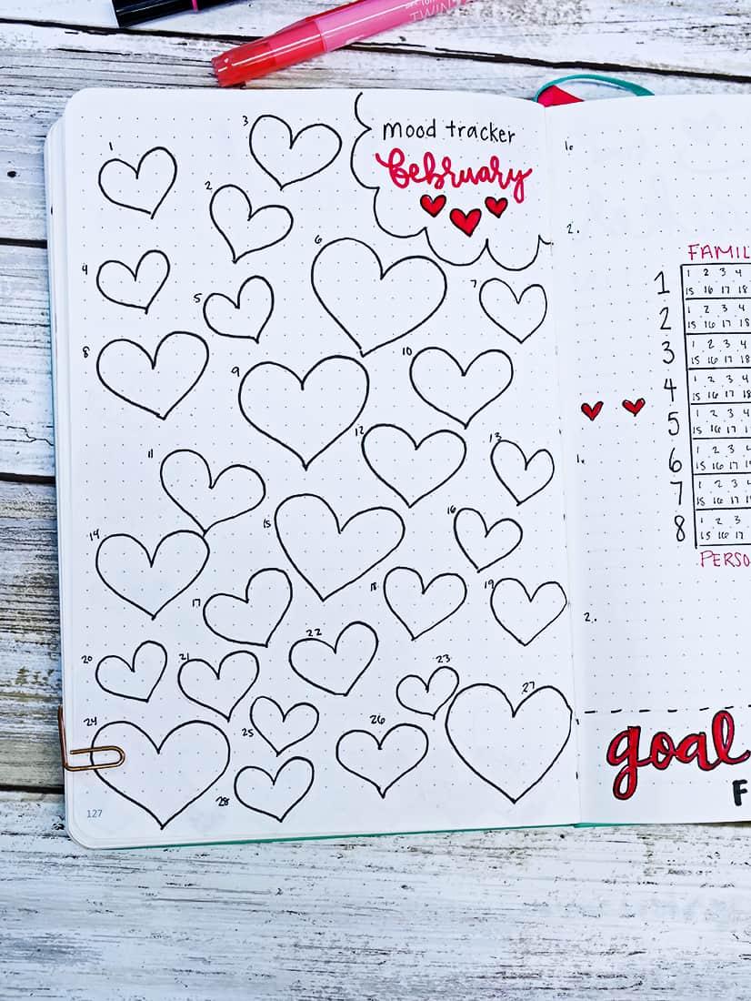 Bullet journal heart doodle mood tracker for February