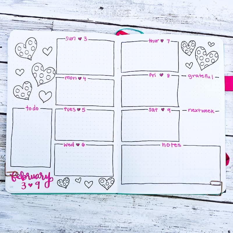 Bullet journal weekly setup with polka dot hearts
