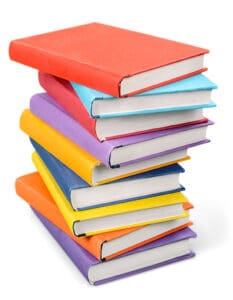 Pile of colorful journaling notebooks