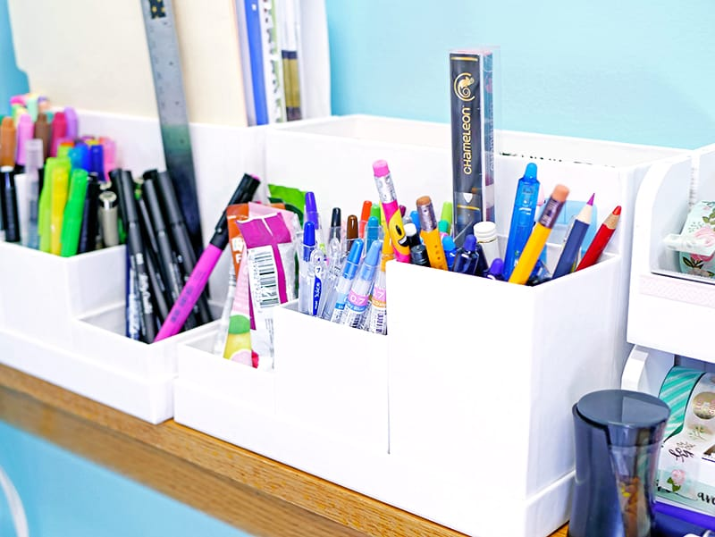 Organized journaling supplies and pens on a desk