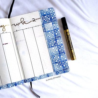 Tile stamps decorating a bullet journal