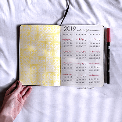 Year at a glance with decorative yellow tile stamps.