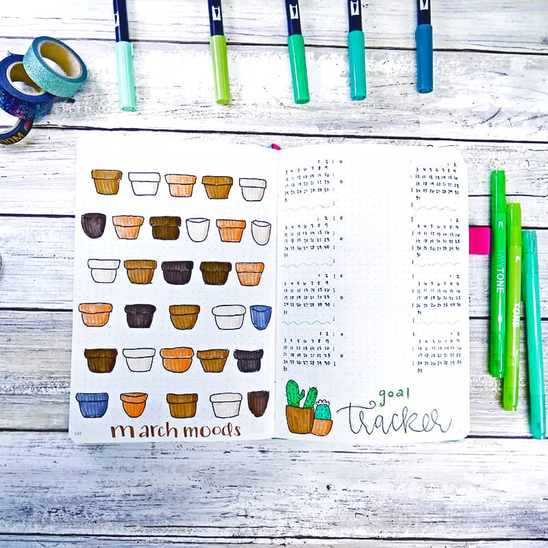 Bullet journal mood tracker and goal tracker with plant art.