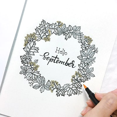 Hello September bullet journal page with plant wreath.