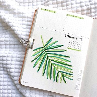 Big leaf doodle bullet journal weekly spread.